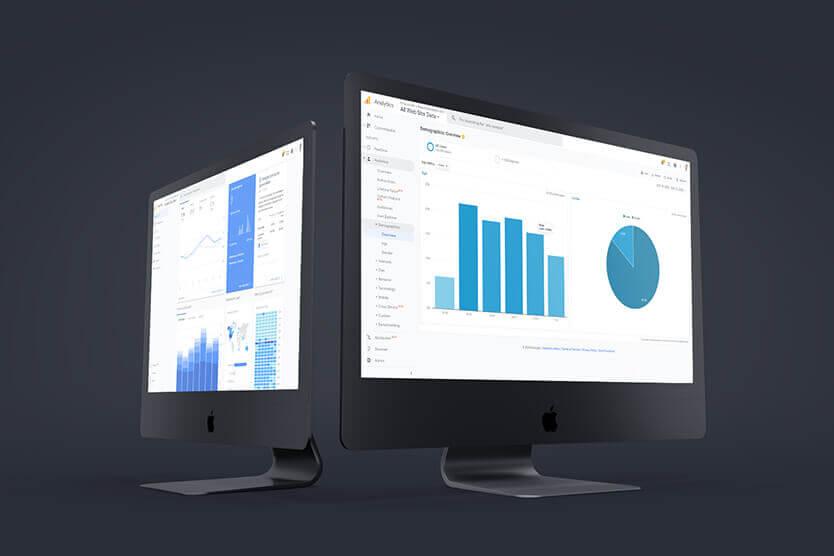 SEO Search Engine Optimization - Dual monitors showing Google Analytics screens